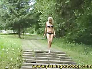 Janna piddles on a ladder
