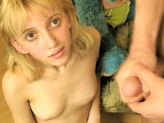 Pang legged blonde teen shows off her tight shaved pussy
