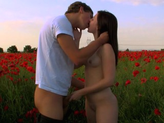 Legal Age Teenagers strip on a wide flower field to make out and fuck