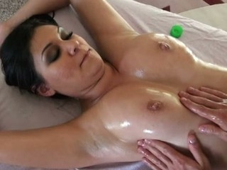 Stud is giving sexy darling a lusty oil rubbing on her love tunnel